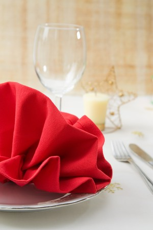 Christmas decorated table for a menu with red folded napkin. photo