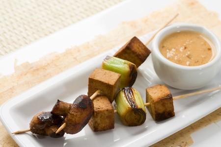 Asian vegetarian skewers made from mushrooms, tofu and leek photo