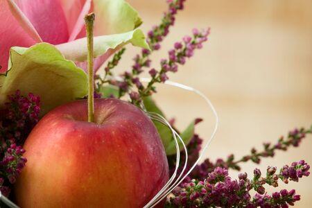 autumnally: Decorative autum flower arrangement with erica and apple.