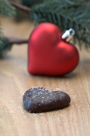 Christmas image with hearts from German Lebkuchen and as decoration, a fir branch and copy space. Stock Photo - 7946815