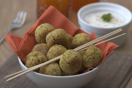 Bowl with falafel which are vegetarian and made from chickpeas. photo
