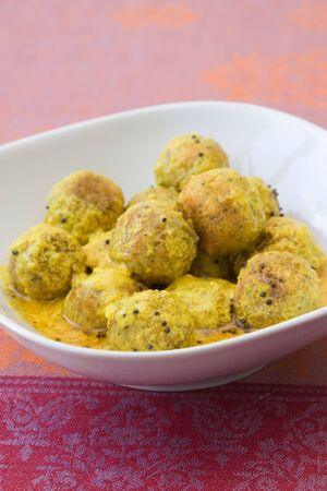 Bowl with a falafel curry which is a typical Indian dish. photo