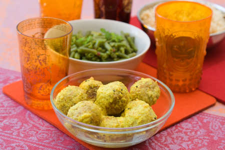 Oriental menu with falafel, green beans and rice. photo