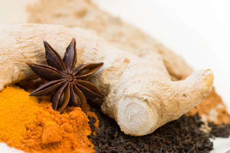 still lifes: Decorative close-up image of spices like ginger, star anise, curcuma and black tea.