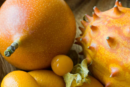 hedged: Selective focus image of different tropical fruits like horned melon, physalis, passion fruits and cumquats.