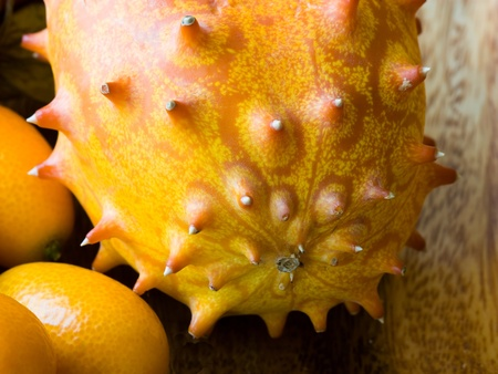 hedged: Selective focus image of a horned melon and cumquats.
