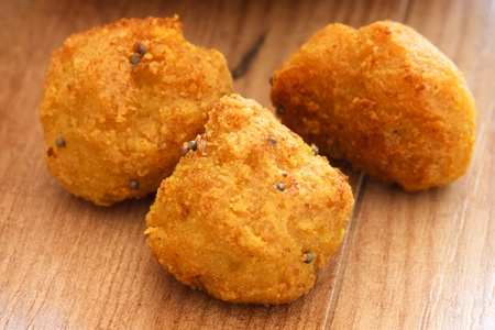 Close-up image of fried chick-pea balls on a wooden background. photo