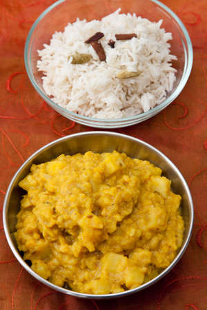 Image of rice with spices and an Indian dal dish made from mung beans and cauliflower. photo