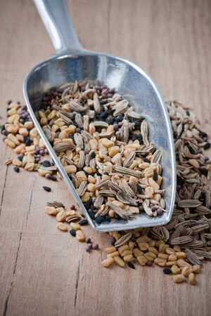 mustard seed: Drawer with Panch Phoron which is an Indian blend spice and which is made in equal measure from fennel seed, cumin seed, mustard seed, fenugreek and black cumin. Stock Photo