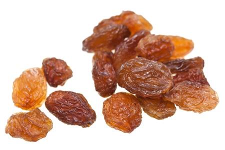 Isolé des raisins secs avec fond blanc.