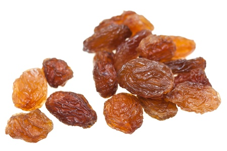 sultanas: Isolated dried raisins with white background. Stock Photo