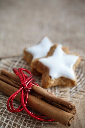 Selective focus image of cinnamon sticks and star-shaped cinnamon biscuits. Stock Photo - 10266404