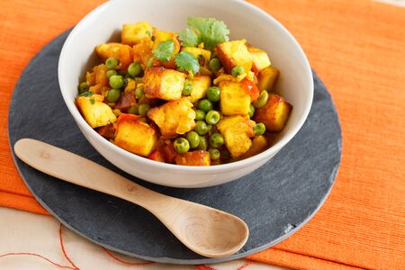paneer: Image of mattar paneer, an Indian vegetarian dish with  paneer and peas in a spicy sauce. Stock Photo