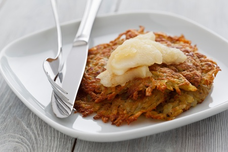 Rosti with apple compote on a wooden background.