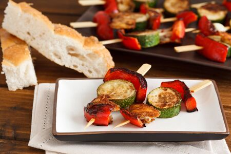 Fried vegetable skewers with red bell pepper, zucchini and halloumi cheese, decorated as cottage style. Stock Photo - 11177329