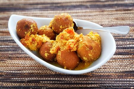 chick pea: Indian chick pea balls with a sauce made from yogurt and tomatoes.