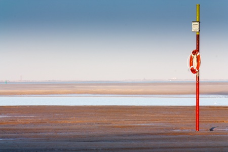lifesaver: View of the North Sea and a lifesaver at the beach of Langeoog  Stock Photo