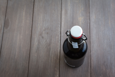 Beer bottle on brown planks
