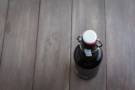 brown bottles: Beer bottle on brown planks