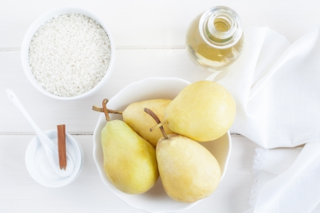 Ingredients for a rice pudding dessert: pears, rice pudding, sugar, wine. Stock Photo - 15428719