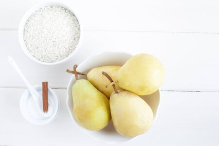 Ingredients for a rice pudding dessert: pears, rice pudding, sugar. Stock Photo - 15428717