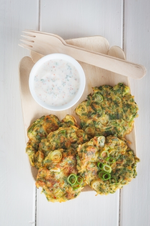 fritters: Bowl with zucchini fritters. Stock Photo