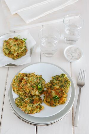 cocozelle: Dishes with zucchini pancakes. Stock Photo