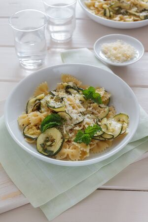 Pasta dish with marinated zucchini. photo