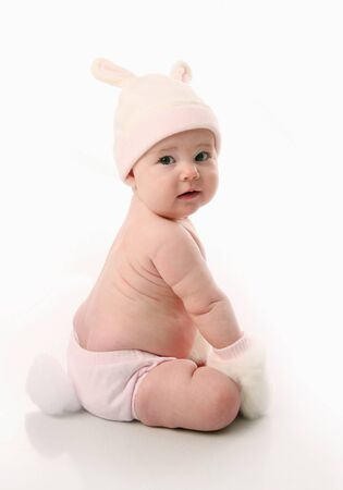 Cute baby girl wearing bunny rabbit ears and tail Easter costume, isolated on white Stock Photo - 8382896