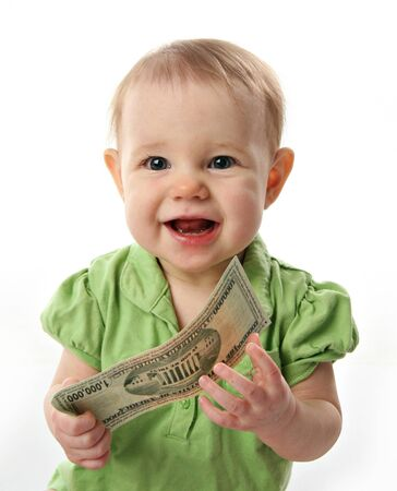 Cute baby girl smiling holding on to a million dollar bill  money photo