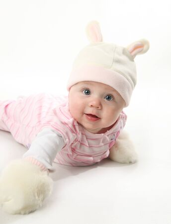 Portrait of an adorable baby girl wearing a bunny rabbit costume and furry mittens Standard-Bild
