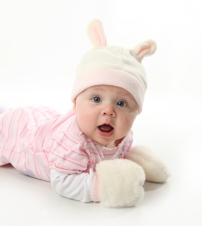 baby clothing: Portrait of an adorable baby girl wearing a bunny rabbit costume  Stock Photo