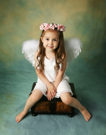 baby girls smiley face: Beautiful young girl wearing angel wings and flower halo with smile happy expression