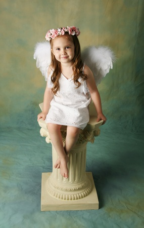 Beautiful young girl wearing angel wings and flower halo with smile happy expression Stock Photo - 8710153