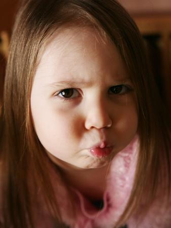 Cute preschool girl making a pouty expression