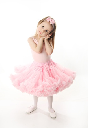 Portrait of an adorable preschool age girl playing dress up wearing a ballet tutu, isolated on white Stock Photo - 9939635