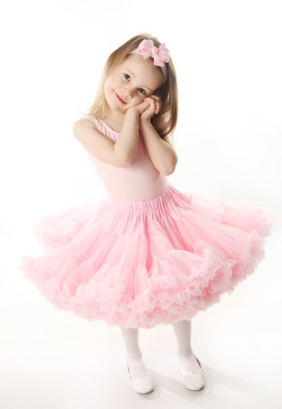 Portrait of an adorable preschool age girl playing dress up wearing a ballet tutu, isolated on white Stock Photo - 9939702
