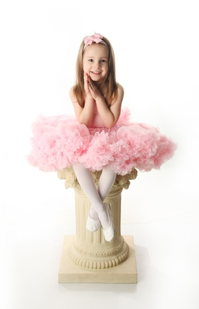 ballet tutu: Portrait of an adorable preschool age girl playing dress up wearing a ballet tutu, isolated on white