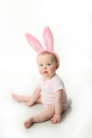Portrait of a cute baby dressed in Easter bunny photo