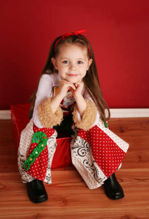 Adorable preschool girl wearing a Christmas holiday outfit posing photo