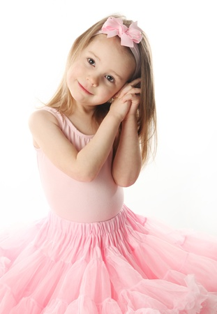 Portrait of an adorable preschool age girl playing dress up wearing a ballet tutu, isolated on white Stock Photo - 9939565
