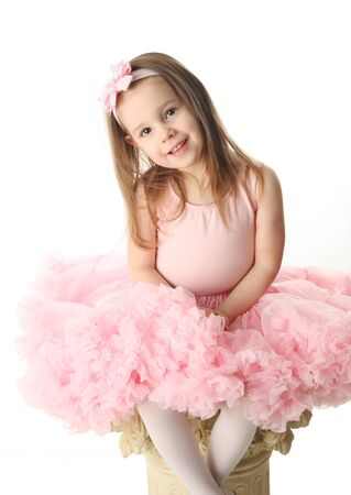 Portrait of an adorable preschool age girl playing dress up wearing a ballet tutu, isolated on white Stock Photo - 9939588