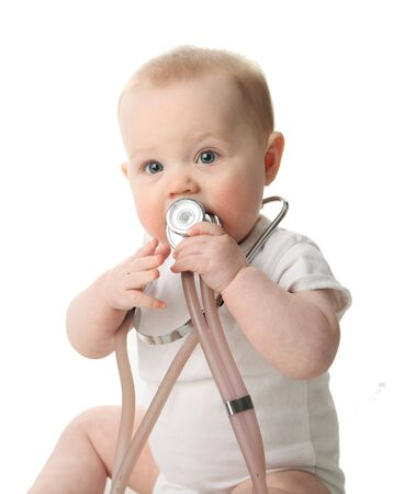 Portrait of a cute baby sitting playing with a stethoscope  photo