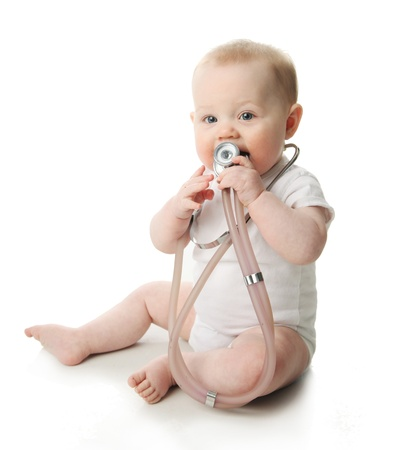 funny doctor: Portrait of a cute baby sitting playing with a stethoscope  Stock Photo