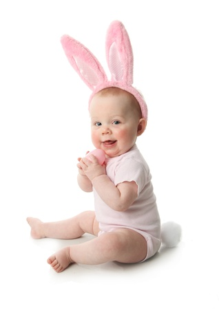 Portrait of a cute baby dressed in Easter bunny ears pastel eggs Standard-Bild