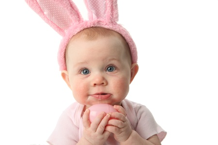 Portrait of a cute baby dressed in Easter bunny ears pastel eggs Stok Fotoğraf