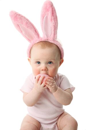 Portrait of a cute baby dressed in Easter bunny ears pastel eggs photo