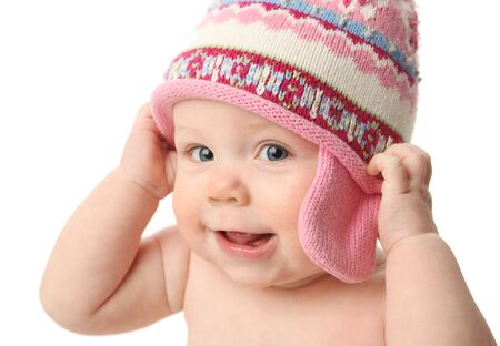 close knit: Close up portrait of an adorable baby wearing a knit winter cap, isolated on white