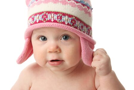 white winter: Close up portrait of an adorable baby wearing a knit winter cap, isolated on white