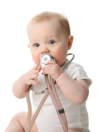 Adorable baby sitting up wearing and playing with a medical stethoscope, isolated on white Standard-Bild